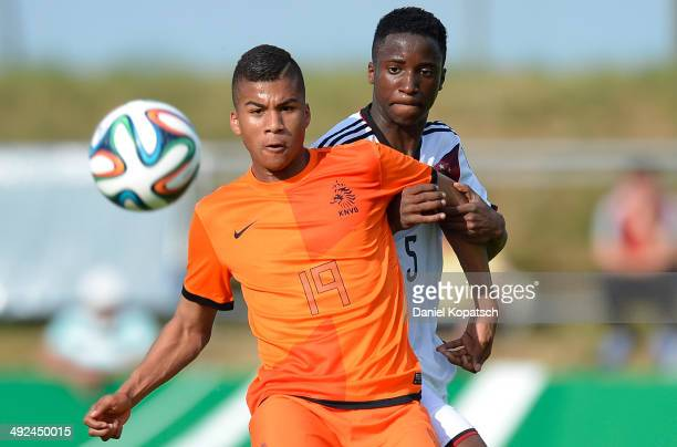 Anderson Lopez of the Netherlands is challenged by Panzu Ernesto of Germany during the international friendly U15 match between Germany and...
