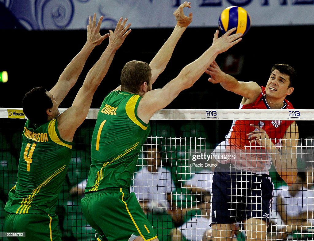Anderson Matthew of United States spikes the ball as Paul Sanderson and Aidan Zingel #1 of Australia block during the FIVB World League Final Six match between United States and Australia at Mandela Forum on July 17, 2014 in Florence, Italy.