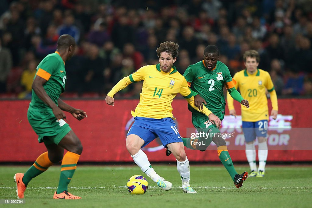 Anderson Maxwell of Brazil (2nd Left) competes the ball with Jimmy Chisenga of Zambia (2nd Right) during the international friendly match between Brazil and Zambia at Beijing National Stadium on October 15, 2013 in Beijing, China.