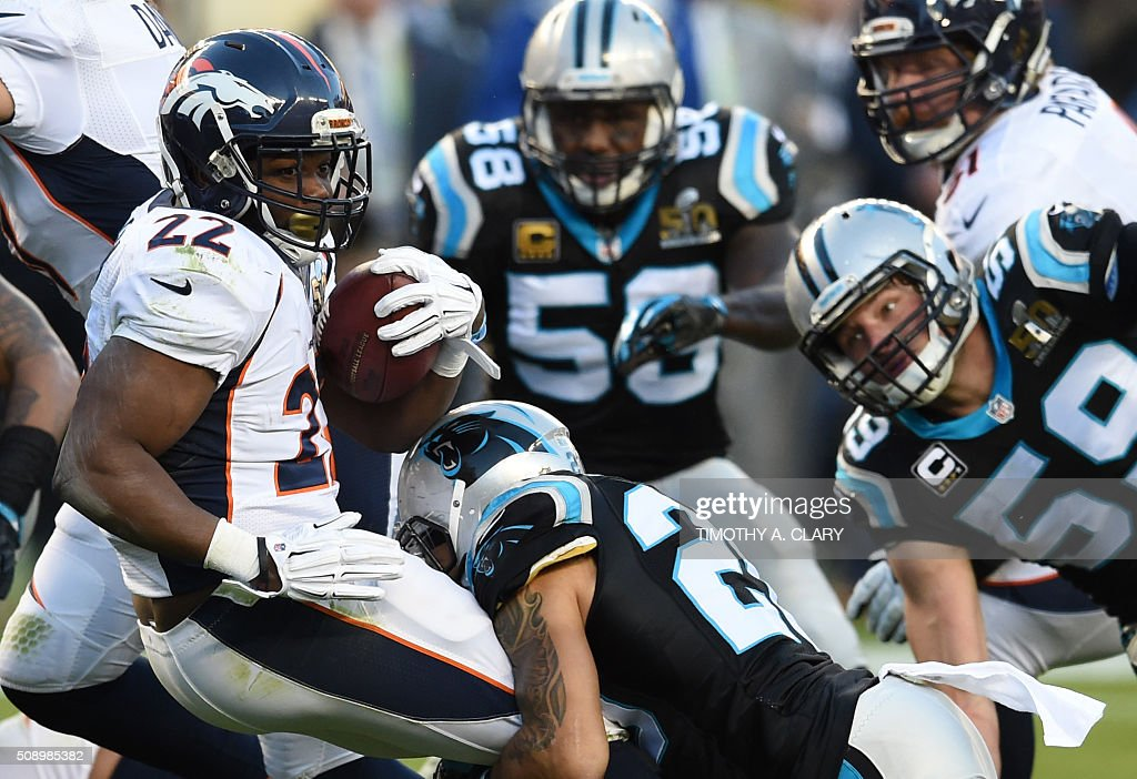 C.J. Anderson (L) of Denver Broncos is taken down during Super Bowl 50 against the Carolina Panthers at Levi's Stadium in Santa Clara, California, on February 7, 2016. / AFP / TIMOTHY A. CLARY
