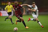 Anderson of Eintracht Frankfurt is challenged by Patrick Herrmann of Borussia Moenchengladbach during the Bundesliga match between Eintracht...