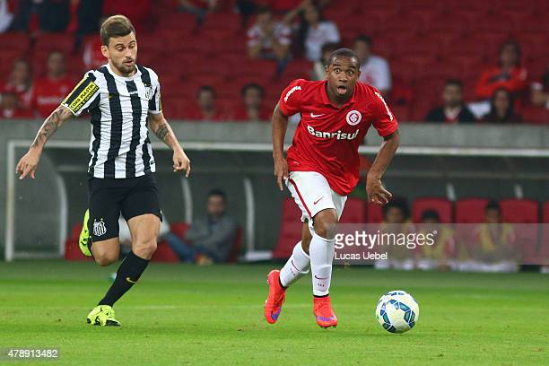 Anderson of Internacional battles for the ball against Lucas Lima of Santos during the match between Internacional and Santos as part of Brasileirao...