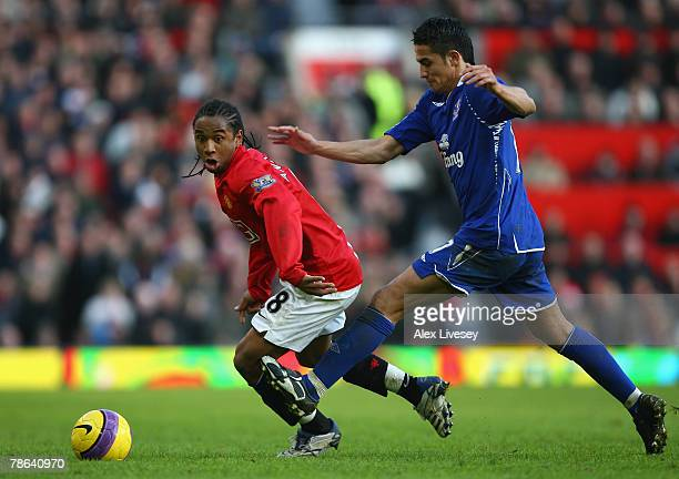 Anderson of Manchester United beats Tim Cahill of Everton during the Barclays Premier League match between Manchester United and Everton at Old...