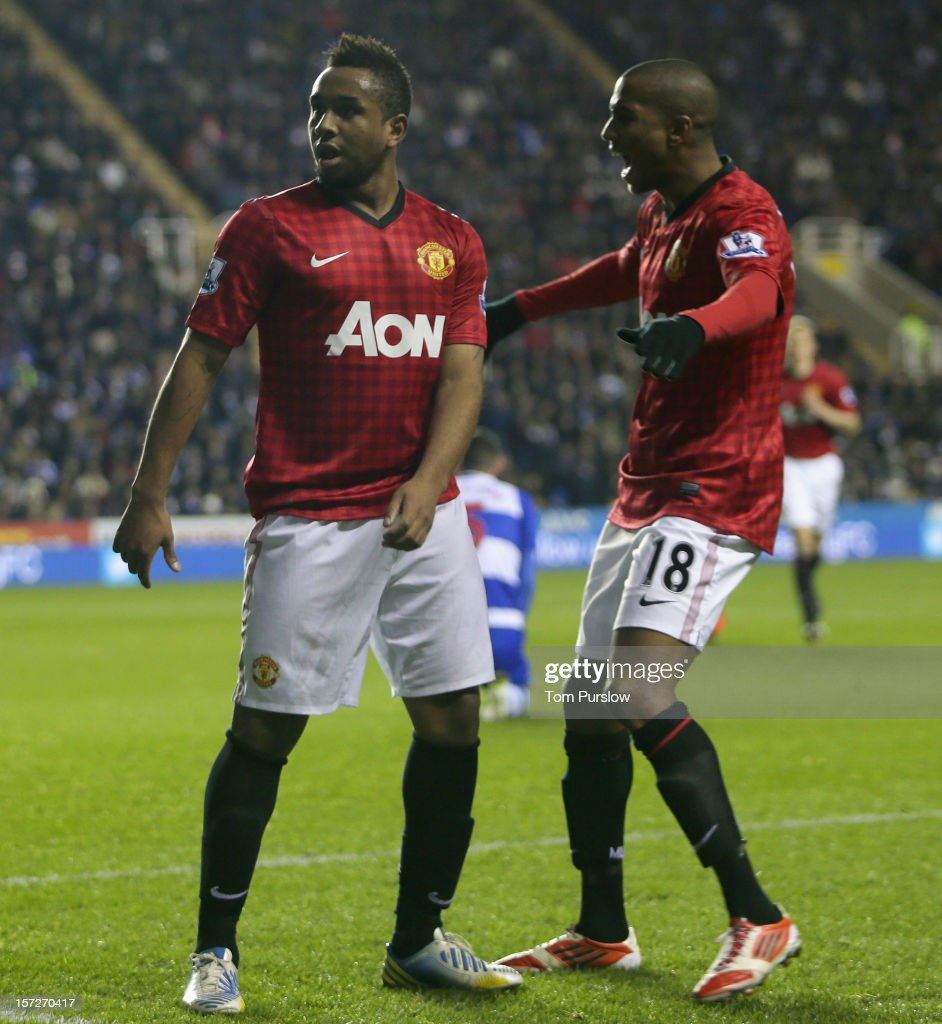 Anderson (L) of Manchester United celebrates scoring their first goal during the Barclays Premier League match between Reading and Manchester United at Madejski Stadium on December 1, 2012 in Reading, England.