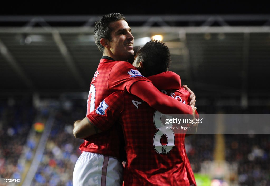 Anderson of Manchester United celebrates scoring with teammate Robin van Persie during the Barclays Premier League match between Reading and Manchester United at Madejski Stadium on December 1, 2012 in Reading, England.