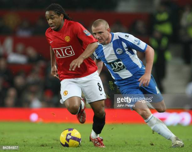 Anderson of Manchester United clashes with Lee Cattermole of Wigan Athletic during the Barclays Premier League match between Manchester United and...