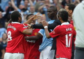 Anderson of Manchester United clashes with Mario Balotelli of Manchester City after final whistle of the FA Cup sponsored by Eon SemiFinal match...