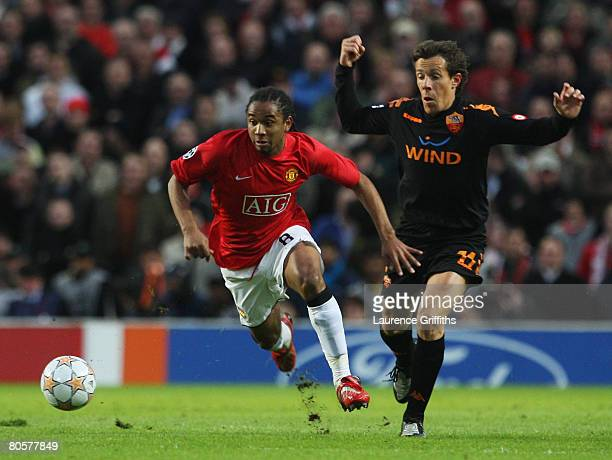 Anderson of Manchester United evades Rodrigo Taddei of AS Roma during the UEFA Champions League Quarter Final 2nd leg match between Manchester United...