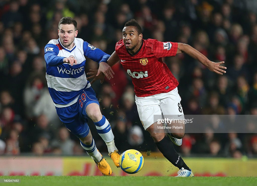 Anderson of Manchester United in action with Danny Guthrie of Reading during the FA Cup Fifth Round match between Manchester United and Reading at Old Trafford on February 18, 2013 in Manchester, England.