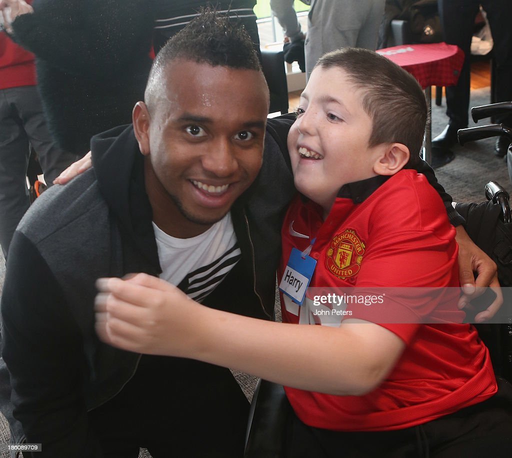 Anderson of Manchester United meets Harry during a Manchester United Foundation Dream Day, for fans with life-limiting illnesses, at Aon Training Complex on October 28, 2013 in Manchester, England.