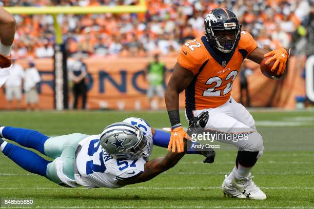J Anderson of the Denver Broncos breaks a run as Damien Wilson of the Dallas Cowboys misses a tackle during the first quarter on Sunday September 17...
