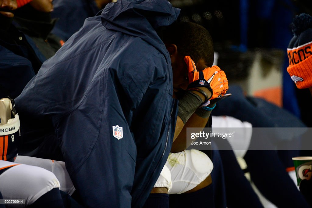 C.J. Anderson (22) of the Denver Broncos can't watch as the Bengals kick a field goal to tie the game. The Denver Broncos played the Cincinnati Bengals at Sports Authority Field at Mile High in Denver, CO on December 28, 2015.