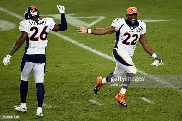 J Anderson of the Denver Broncos runs on to the field and high fives Darian Stewart of the Denver Broncos at the end of the game The Broncos defeated...