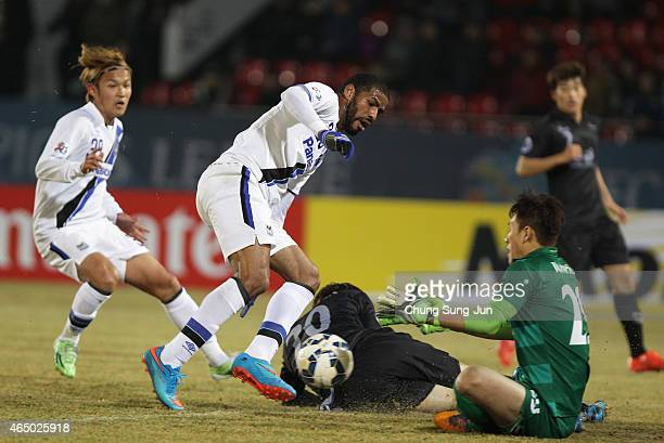 Anderson Patric Aguiar Oliveira of Gamba Osaka compete for the ball with Park JunHuk of Seongnam FC during the AFC Champions League Group F match...