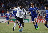Anderson Patric Aguiar Oliveira of Gamba Osaka competes for the ball with Park HyunBem of Suwon Samsung Bluewings during the AFC Champions League...