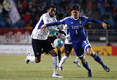 Anderson Patric Aguiar Oliveira of Gamba Osaka competes for the ball with Yeon JeiMin of Suwon Samsung Bluewings during the AFC Champions League...