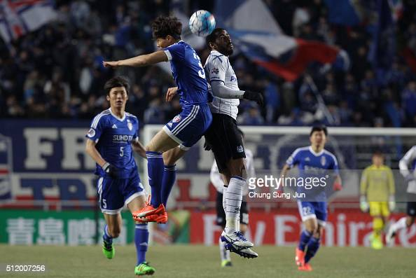Anderson Patric Aguiar Oliveira of Gamba Osaka competes for the ball with Min SangGi of Suwon Samsung Bluewings during the AFC Champions League Group...