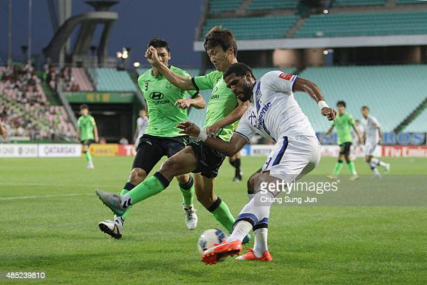 Anderson Patrick Aguiar Oliveira of Gamba Osaka compete for the ball with Han KyoWon of Jeonbuk Hyundai Motors during the AFC Champions League...