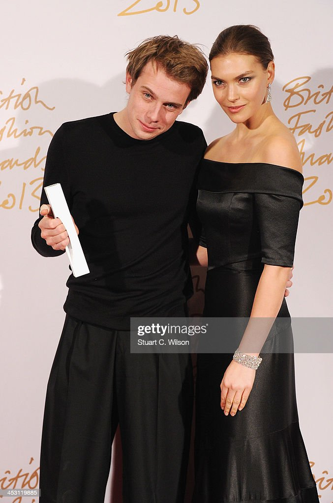 JW Anderson (L) poses with the Award for New Establishment Designer and <a gi-track='captionPersonalityLinkClicked' href=/galleries/search?phrase=Arizona+Muse&family=editorial&specificpeople=7109685 ng-click='$event.stopPropagation()'>Arizona Muse</a> in the winners room at the British Fashion Awards 2013 at London Coliseum on December 2, 2013 in London, England.