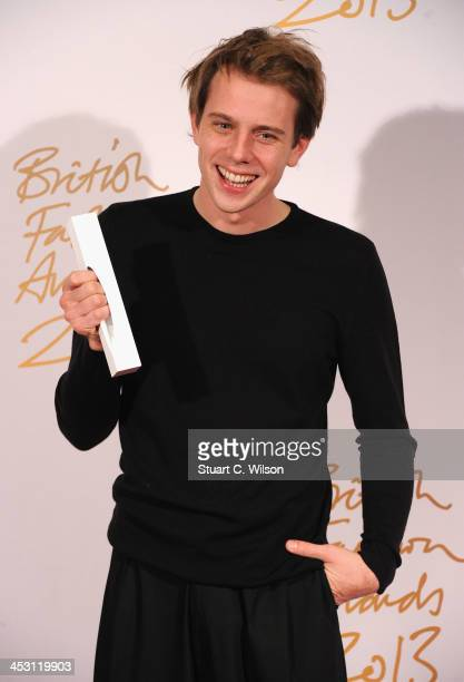 Anderson poses with the Award for New Establishment Designer in the winners room at the British Fashion Awards 2013 at London Coliseum on December 2...