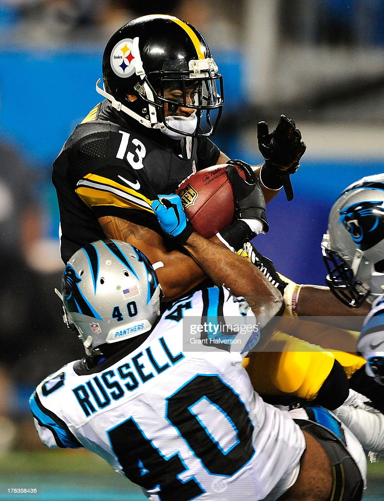 Anderson Russell #40 and Mario Addison #97 of the Carolina Panthers tackle Reggie Dunn #13 of the Pittsburgh Steelers in the end zone for a safety during a preseason NFL game at Bank of America Stadium on August 29, 2013 in Charlotte, North Carolina. The Panthers won 25-10.