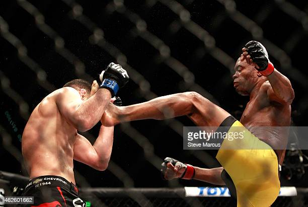 Anderson Silva kicks Nick Diaz in their middleweight bout during UFC 183 at the MGM Grand Garden Arena on January 31 2015 in Las Vegas Nevada Silva...