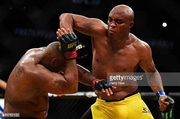 Anderson Silva of Brazil elbows Daniel Cormier in their light heavyweight bout during the UFC 200 event on July 9 2016 at TMobile Arena in Las Vegas...