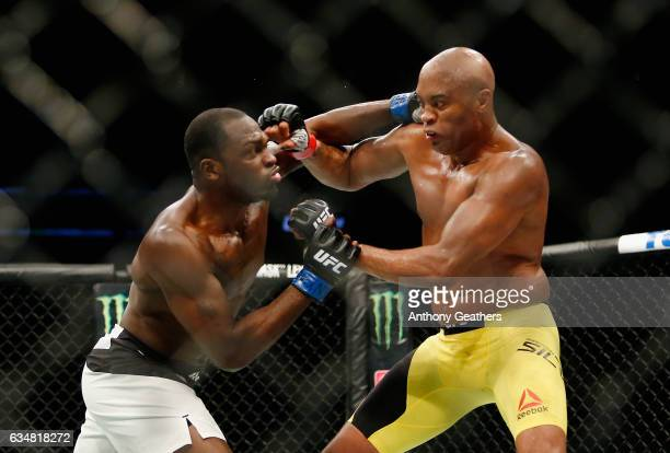 Anderson Silva of Brazil exchanges punches with Derek Brunson of United States in their middleweight bout during UFC 208 at the Barclays Center on...