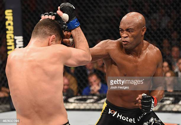 Anderson Silva of Brazil punches Nick Diaz in their middleweight bout during the UFC 183 event at the MGM Grand Garden Arena on January 31 2015 in...