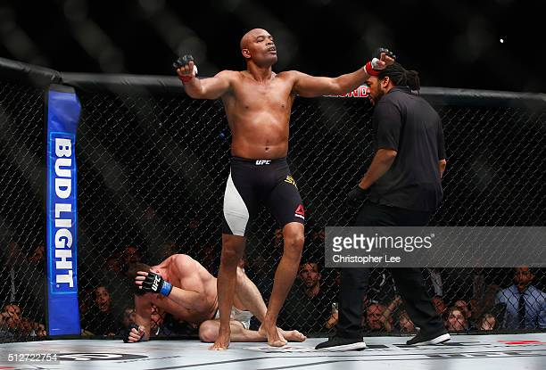 Anderson Silva of Brazil starts to celebrate his victory believing that he had knocked out Michael Bisping of Great Britain during the Middleweight...