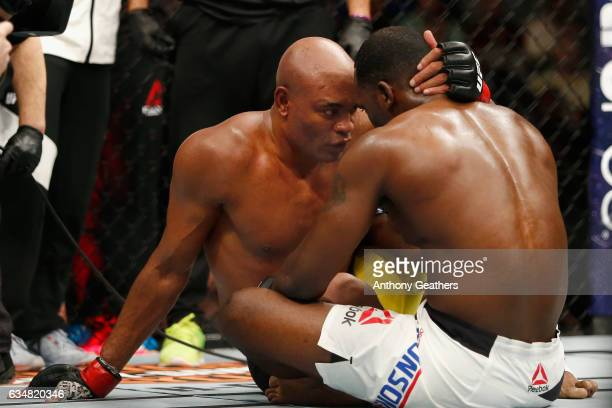 Anderson Silva of Brazil talks with Derek Brunson of United States after their middleweight bout during UFC 208 at the Barclays Center on February 11...