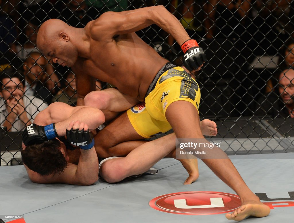 Anderson Silva punches Chael Sonnen during their UFC middleweight championship bout at UFC 148 inside MGM Grand Garden Arena on July 7, 2012 in Las Vegas, Nevada.