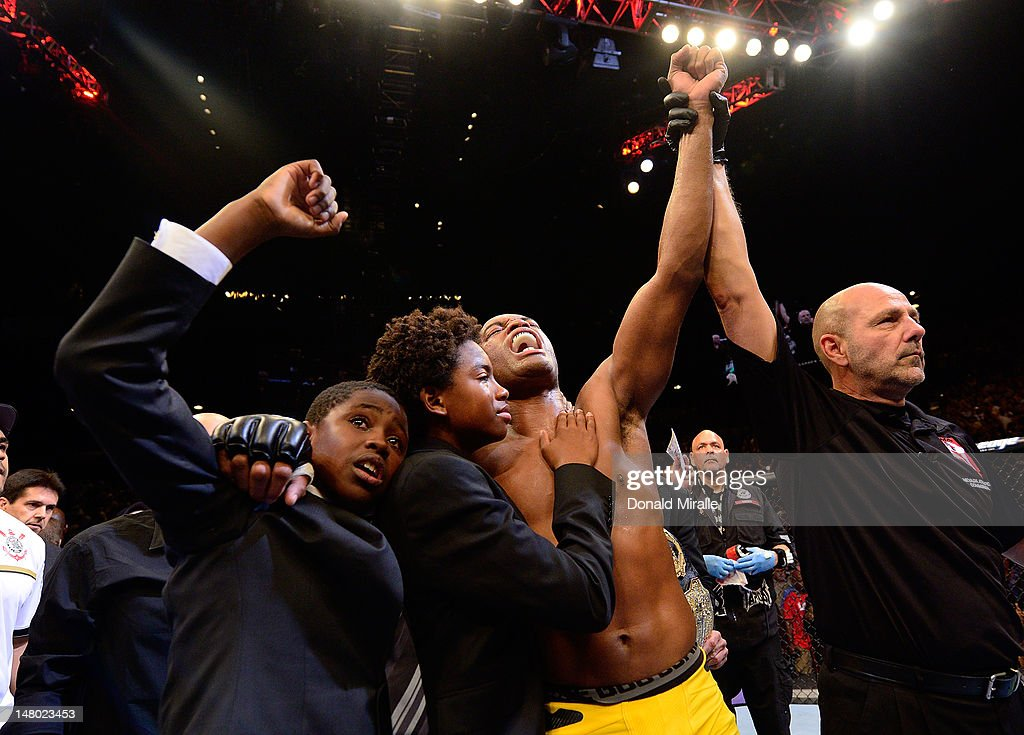 Anderson Silva reacts with his sons after knocking out Chael Sonnen during their UFC middleweight championship bout at UFC 148 inside MGM Grand Garden Arena on July 7, 2012 in Las Vegas, Nevada.