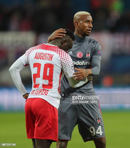 Anderson Talisca of Besiktas Istanbul hugs JeanKevin Augustin of RB Leipzig after the UEFA Champions League group G match between RB Leipzig and...