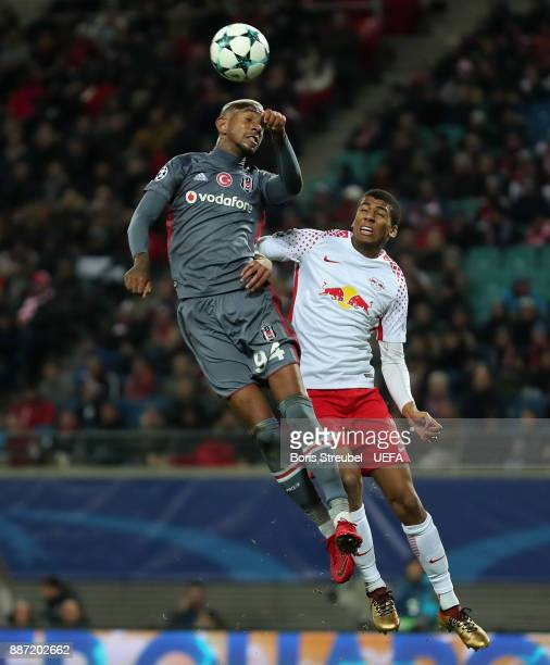 Anderson Talisca of Besiktas Istanbul jumps for a header with Bernardo of RB Leipzig uring the UEFA Champions League group G match between RB Leipzig...