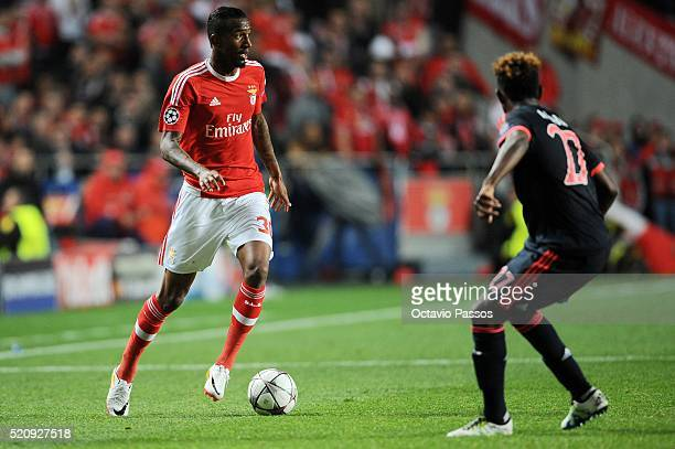 Anderson Talisca of SL Benfica challenges David Alaba of FC Bayern Muenchen during the UEFA Champions league Quarter Final Second Leg match between...