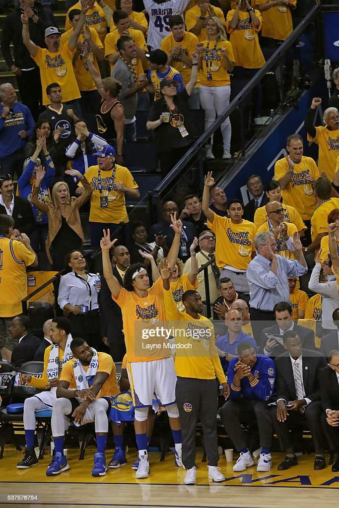 Anderson Varejao #18 and Ian Clark #21 of the Golden State Warriors celebrate a three point basket from the bench in Game Five of the Western Conference Finals against the Oklahoma City Thunder during the 2016 NBA Playoffs on May 26, 2016 at ORACLE Arena in Oakland, California.