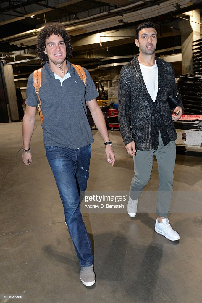 Anderson Varejao #18 and Zaza Pachulia #27 of the Golden State Warriors arrive at the STAPLES Center before the game against the Los Angeles Lakers on November 4, 2016 in Los Angeles, California.