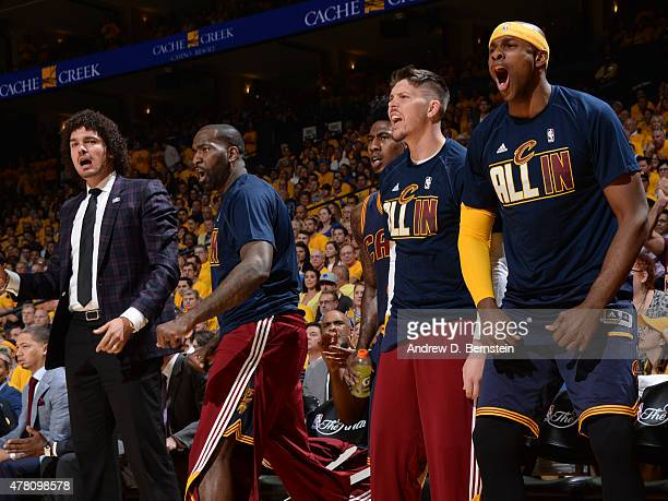 Anderson Varejao Kendrick Perkins Iman Shumpert Mike Miller and Brendan Haywood of the Cleveland Cavaliers cheer during a game against the Golden...