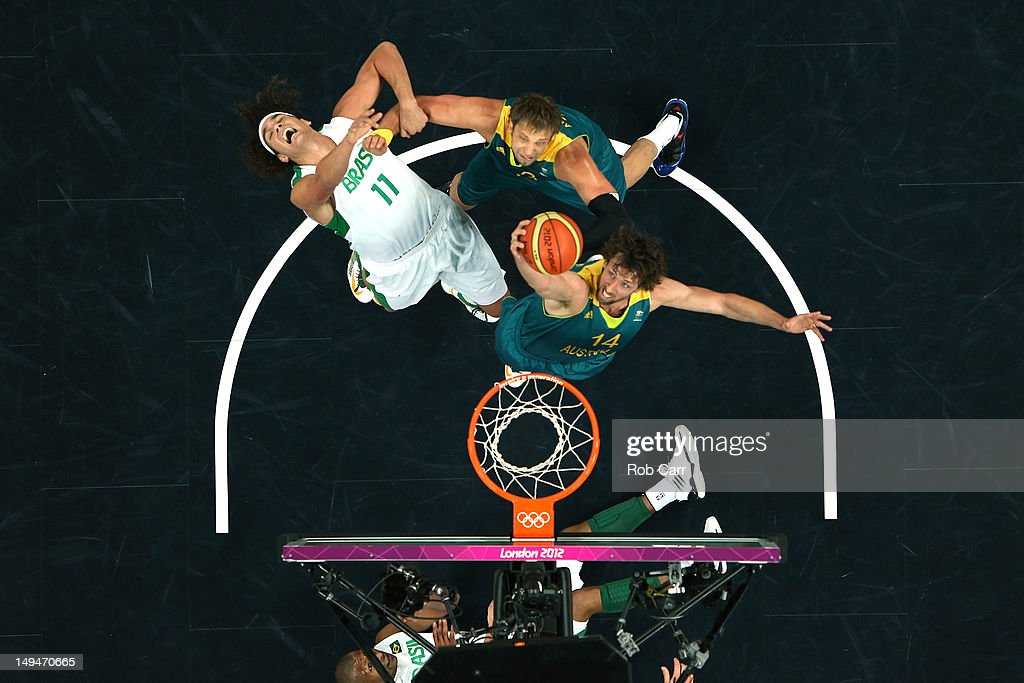 <a gi-track='captionPersonalityLinkClicked' href=/galleries/search?phrase=Anderson+Varejao&family=editorial&specificpeople=202247 ng-click='$event.stopPropagation()'>Anderson Varejao</a> #11 of Brazil gets fouled by <a gi-track='captionPersonalityLinkClicked' href=/galleries/search?phrase=David+Andersen+-+Basketball+Player&family=editorial&specificpeople=14914255 ng-click='$event.stopPropagation()'>David Andersen</a> #13 of Australia as Matt Nielsen #14 goes for the rebound during their Men's Basketball Game on Day 2 of the London 2012 Olympic Games at the Basketball Arena on July 29, 2012 in London, England.