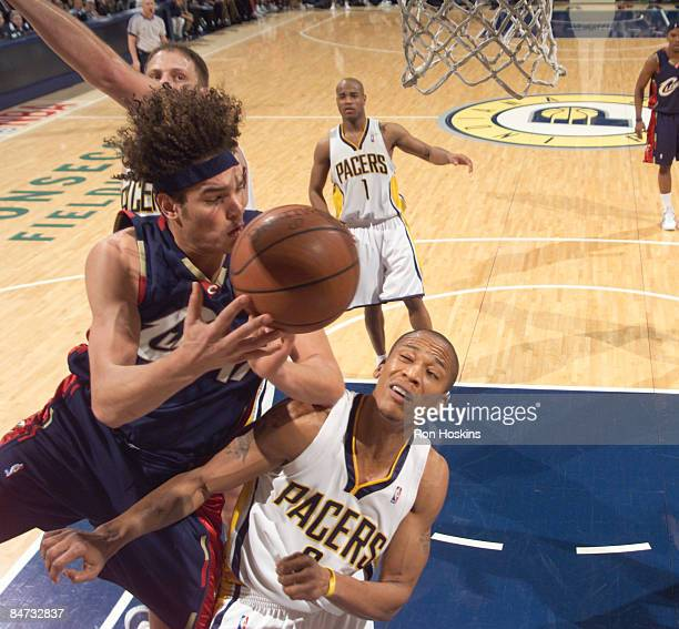 Anderson Varejao of the Cleveland Cavaliers battles Maceo Baston of the Indiana Pacers at Conseco Fieldhouse on February 10 2009 in Indianapolis...