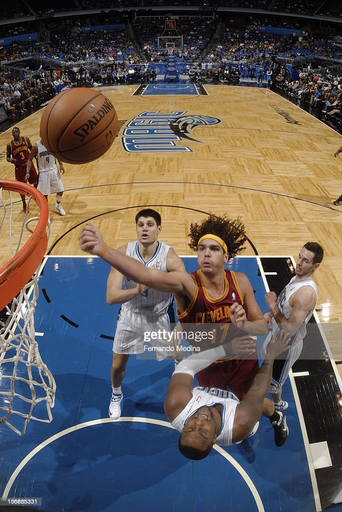 Anderson Varejao #17 of the Cleveland Cavaliers drives to the basket against <a gi-track='captionPersonalityLinkClicked' href=/galleries/search?phrase=Glen+Davis+-+Jogador+de+basquetebol&family=editorial&specificpeople=709385 ng-click='$event.stopPropagation()'>Glen Davis</a> #11 of the Orlando Magic on November 23, 2012 at Amway Center in Orlando, Florida.
