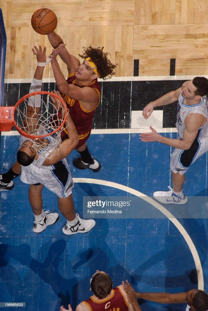 <a gi-track='captionPersonalityLinkClicked' href=/galleries/search?phrase=Anderson+Varejao&family=editorial&specificpeople=202247 ng-click='$event.stopPropagation()'>Anderson Varejao</a> #17 of the Cleveland Cavaliers drives to the basket against <a gi-track='captionPersonalityLinkClicked' href=/galleries/search?phrase=Gustavo+Ayon&family=editorial&specificpeople=4474343 ng-click='$event.stopPropagation()'>Gustavo Ayon</a> #19 of the Orlando Magic on November 23, 2012 at Amway Center in Orlando, Florida.