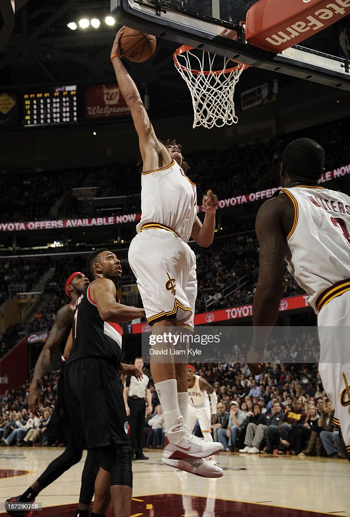 Anderson Varejao #17 of the Cleveland Cavaliers dunks the ball against Jared Jeffries #1 of the Portland Trail Blazers at The Quicken Loans Arena on December 1, 2012 in Cleveland, Ohio.