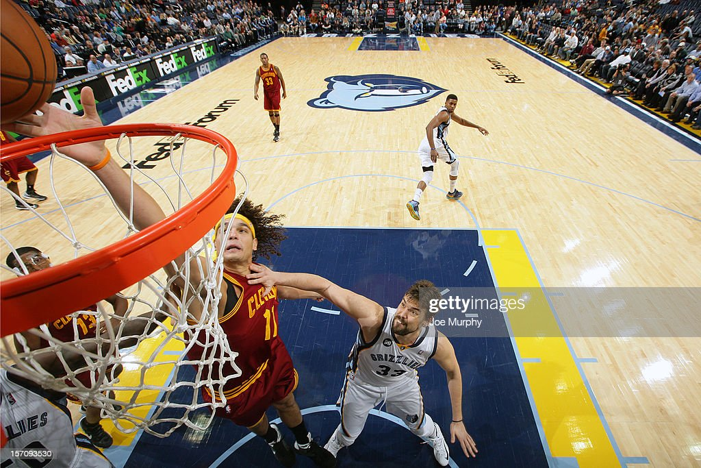 <a gi-track='captionPersonalityLinkClicked' href=/galleries/search?phrase=Anderson+Varejao&family=editorial&specificpeople=202247 ng-click='$event.stopPropagation()'>Anderson Varejao</a> #17 of the Cleveland Cavaliers goes to the basket against <a gi-track='captionPersonalityLinkClicked' href=/galleries/search?phrase=Marc+Gasol&family=editorial&specificpeople=661205 ng-click='$event.stopPropagation()'>Marc Gasol</a> #33 of the Memphis Grizzlies on November 26, 2012 at FedExForum in Memphis, Tennessee.