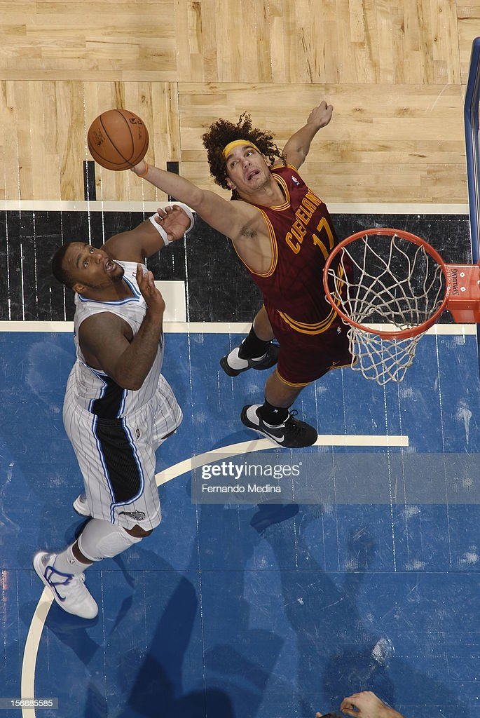 Anderson Varejao #17 of the Cleveland Cavaliers grabs the rebound against <a gi-track='captionPersonalityLinkClicked' href=/galleries/search?phrase=Glen+Davis+-+Jogador+de+basquetebol&family=editorial&specificpeople=709385 ng-click='$event.stopPropagation()'>Glen Davis</a> #11 of the Orlando Magic on November 23, 2012 at Amway Center in Orlando, Florida.