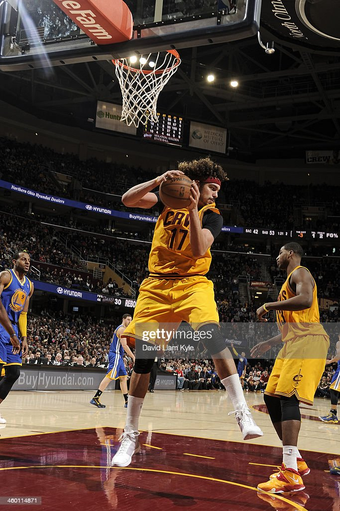 <a gi-track='captionPersonalityLinkClicked' href=/galleries/search?phrase=Anderson+Varejao&family=editorial&specificpeople=202247 ng-click='$event.stopPropagation()'>Anderson Varejao</a> #17 of the Cleveland Cavaliers grabs the rebound against the Golden State Warriors at The Quicken Loans Arena on December 29, 2013 in Cleveland, Ohio.