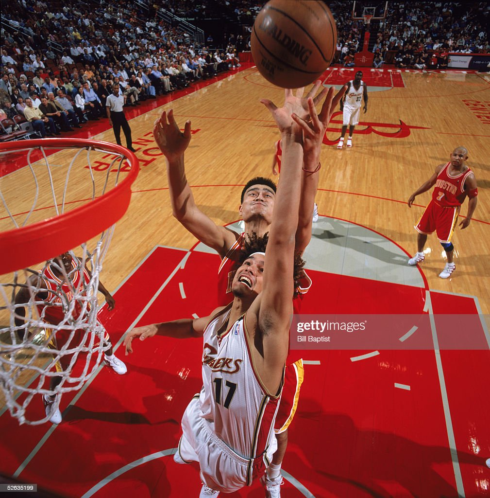 Anderson Varejao #17 of the Cleveland Cavaliers puts a shot up against Yao Ming #11 of the Houston Rockets at Toyota Center on March 24, 2005 in Houston, Texas. The Rockets won 99-80.