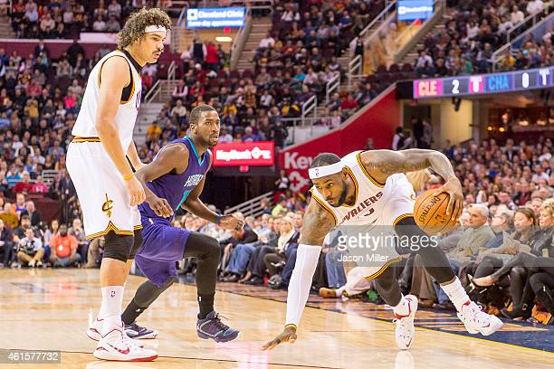 Anderson Varejao of the Cleveland Cavaliers sets a pick for Michael KiddGilchrist of the Charlotte Hornets as Lebron James of the Cleveland Cavaliers...