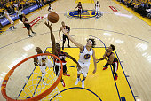 Anderson Varejao of the Golden State Warriors and AlFarouq Aminu of the Portland Trail Blazers go for a rebound during Game Two of the Western...